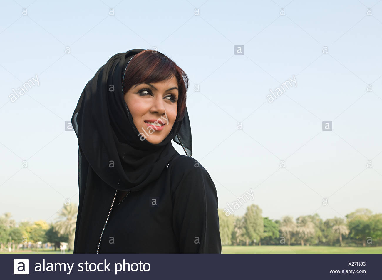 Portrait of a woman wearing a hijab - Stock Image