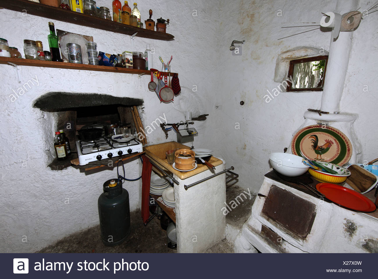 Alicudi, Italy, sparsely furnished kitchen - Stock Image