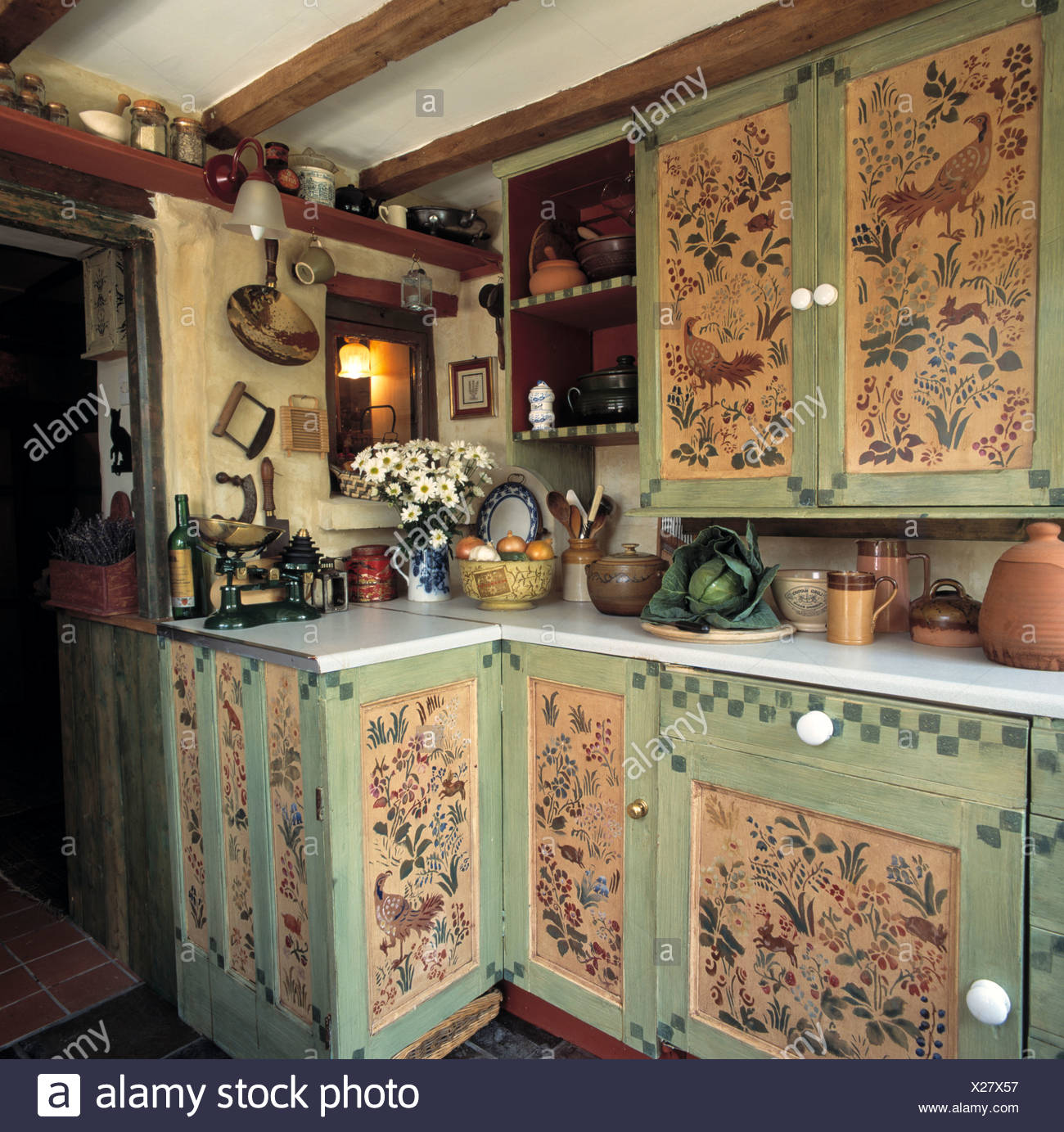 Handpainted Flowers And Birds On Cupboard Doors Of Small Cottage Kitchen Stock Photo Alamy