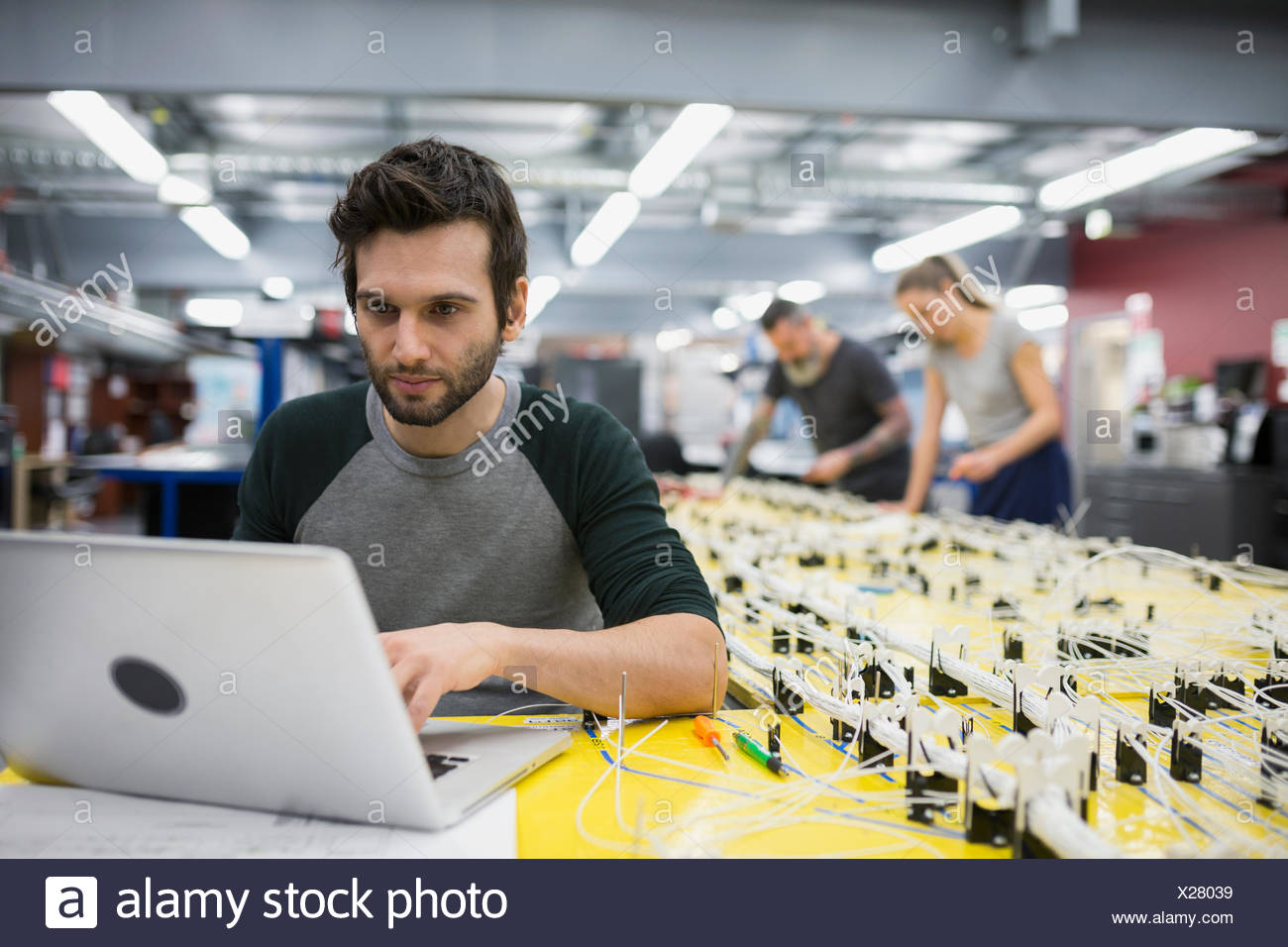 helicopter technician using laptop at wiring harness stock photo rh alamy com