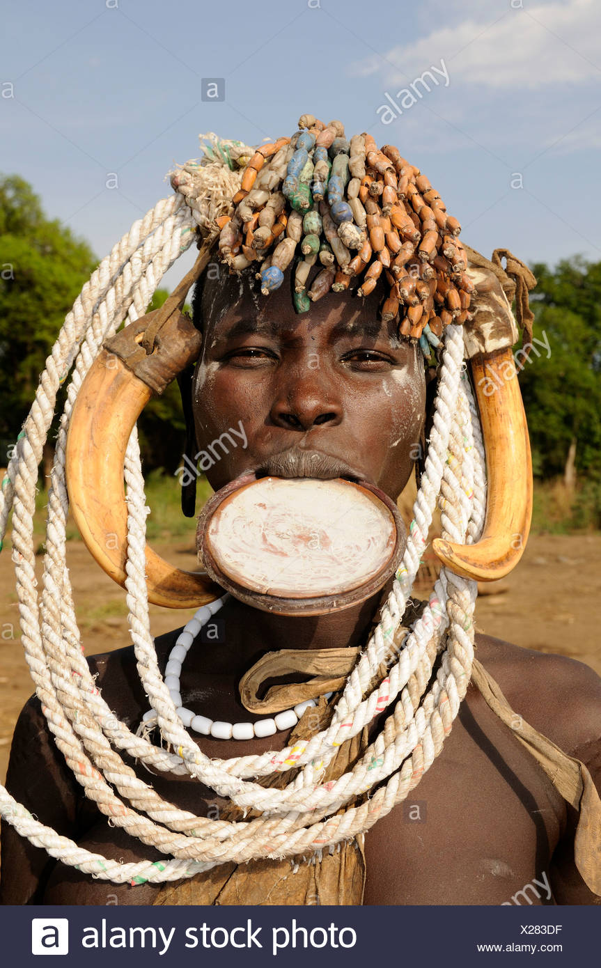 Mursi woman with plate in her lip, Mago National Park, southern Omo valley, southern Ethiopia, Ethiopia, Africa - Stock Image