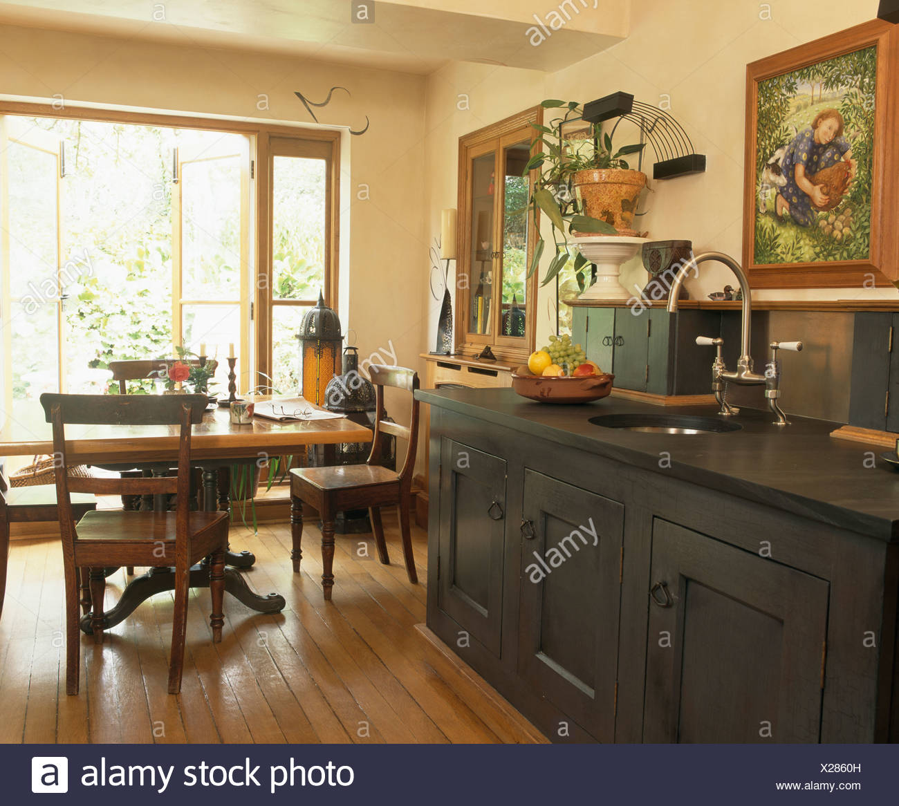 Antique Table And Chairs In Cream Country Kitchen With Reclaimed Oak Flooring And Dark Gray Kitchen Unit With Slate Worktop Stock Photo Alamy
