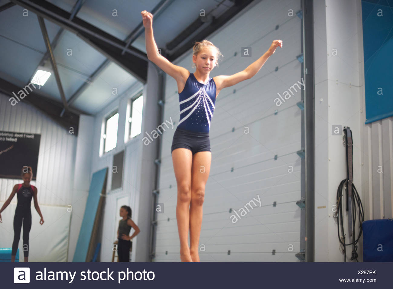 Young gymnasts practising moves - Stock Image