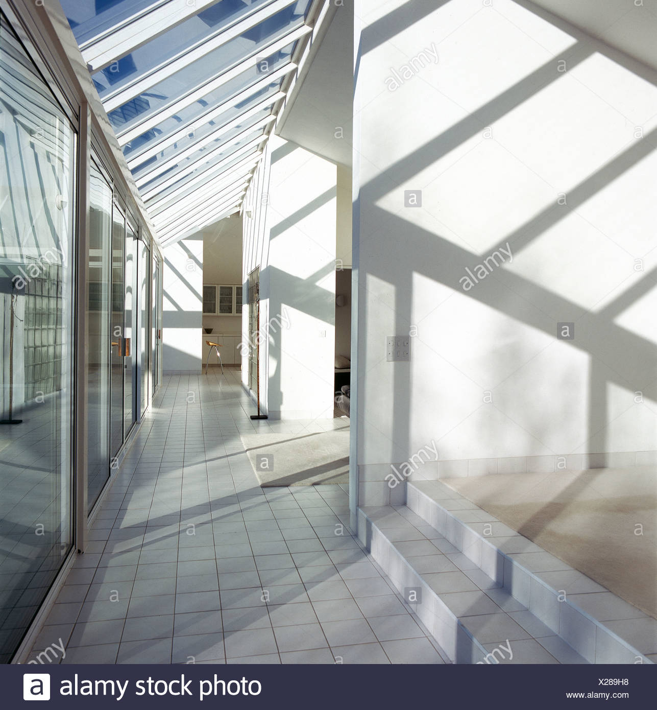 Sliding glass doors in minimalist hallway with white tiled floor and glass roof - Stock Image & Sliding Roof Stock Photos u0026 Sliding Roof Stock Images - Alamy