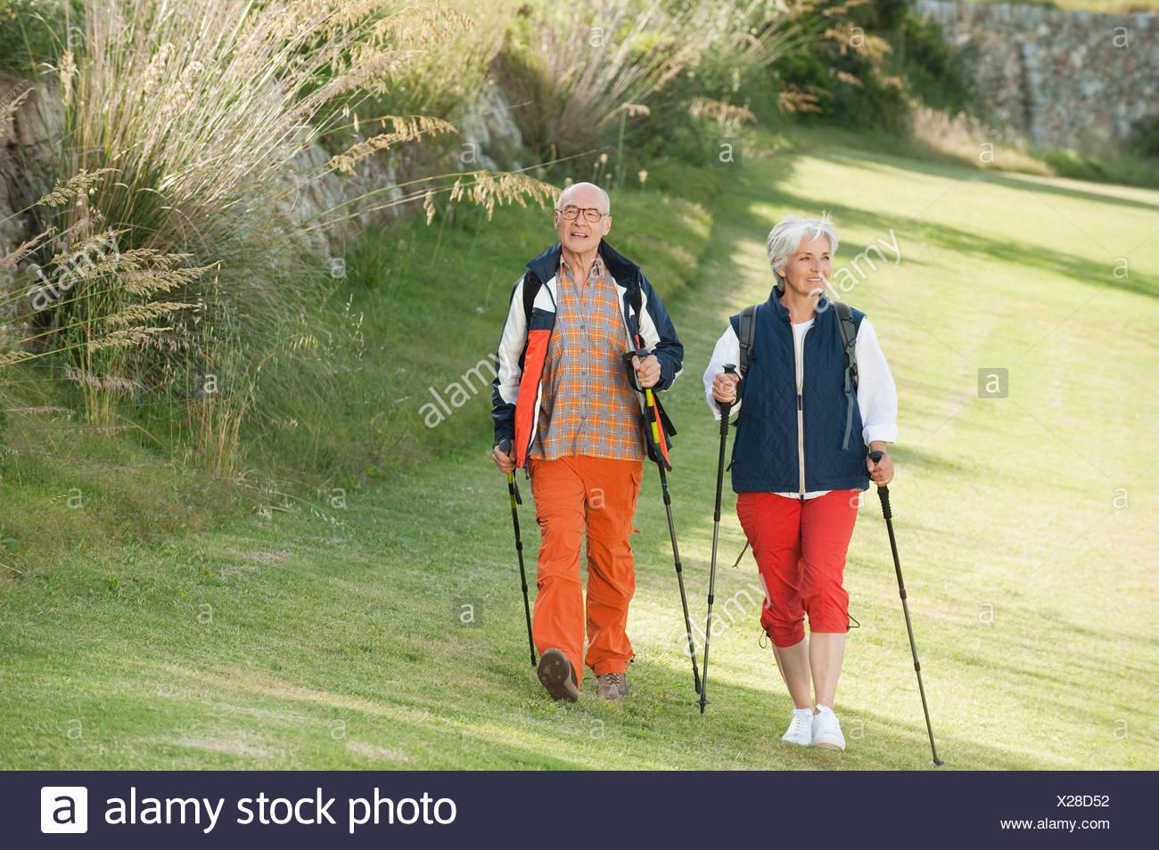 Spain, Mallorca, Senior couple nordic walking - Stock Image