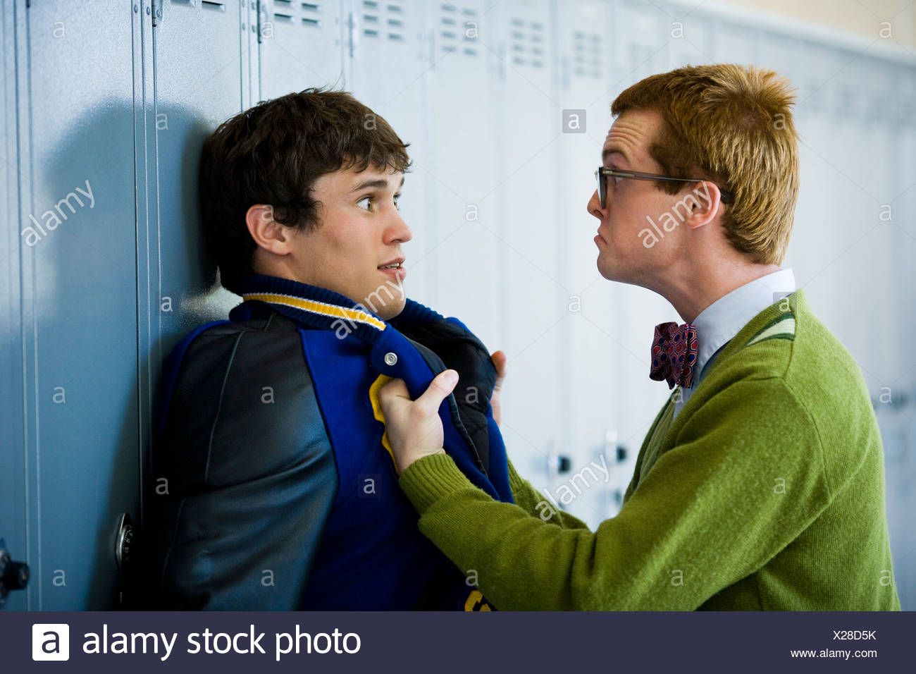 Nerd picking on jock. - Stock Image