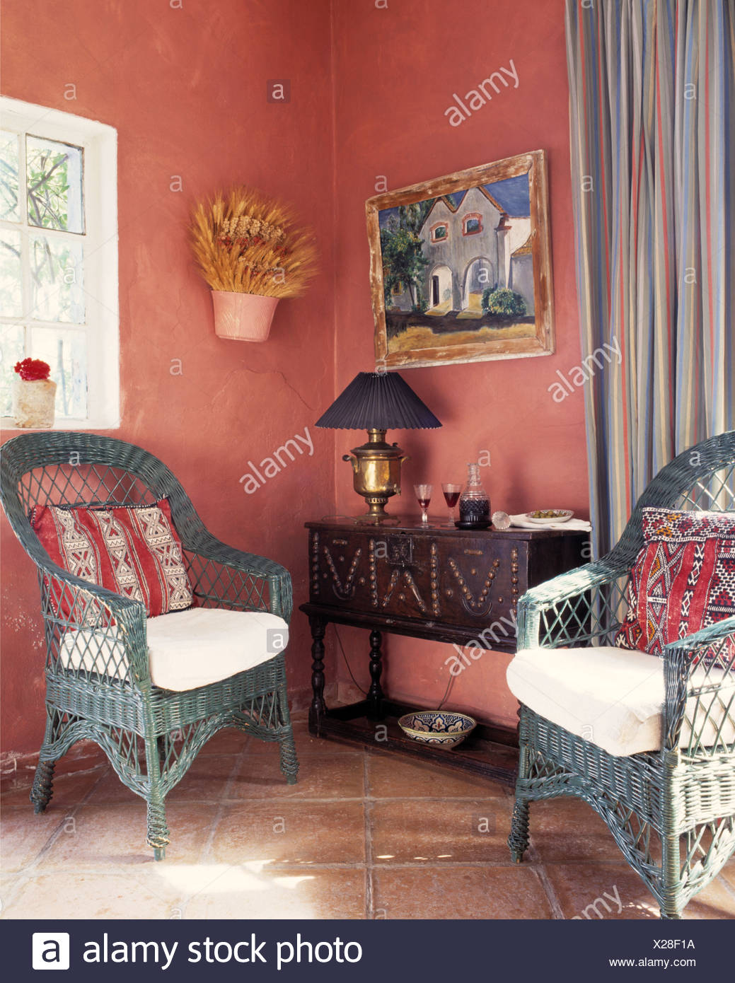 Grey-blue cane chairs with colorful cushions in pink Spanish ...