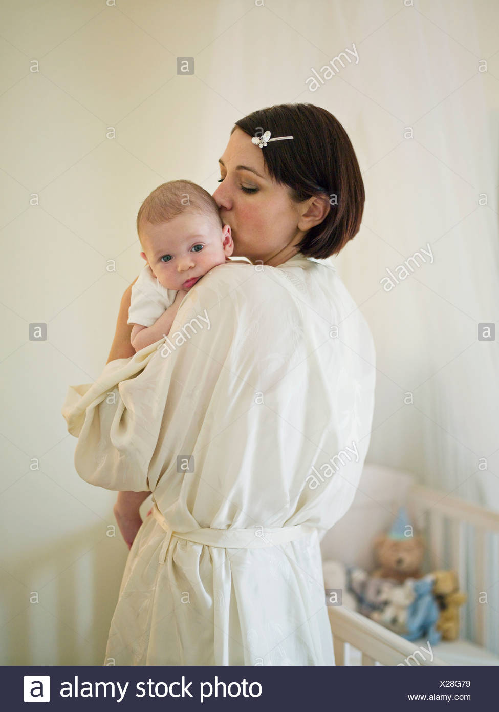 A mother holding a new born baby - Stock Image