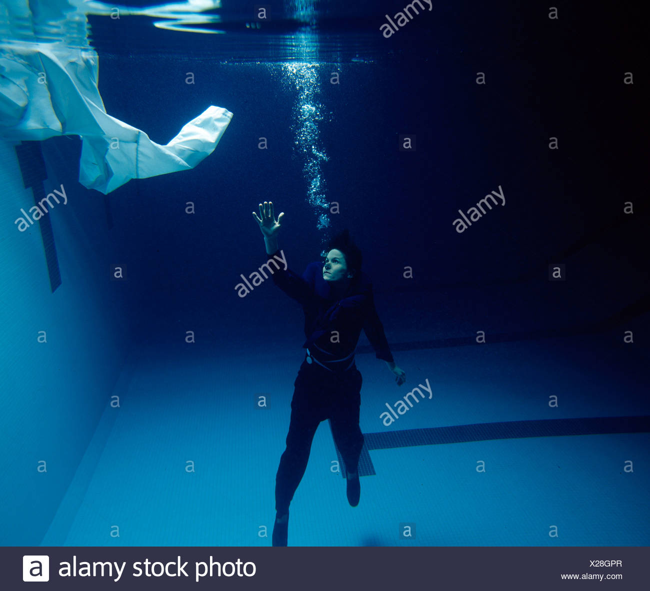 Drowning person reaching for help - Stock Image