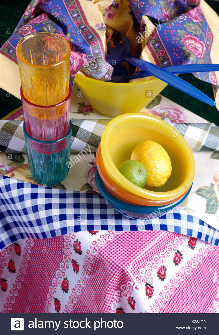 Colourful plastic beakers and bowls ready for picnic Stock Photo