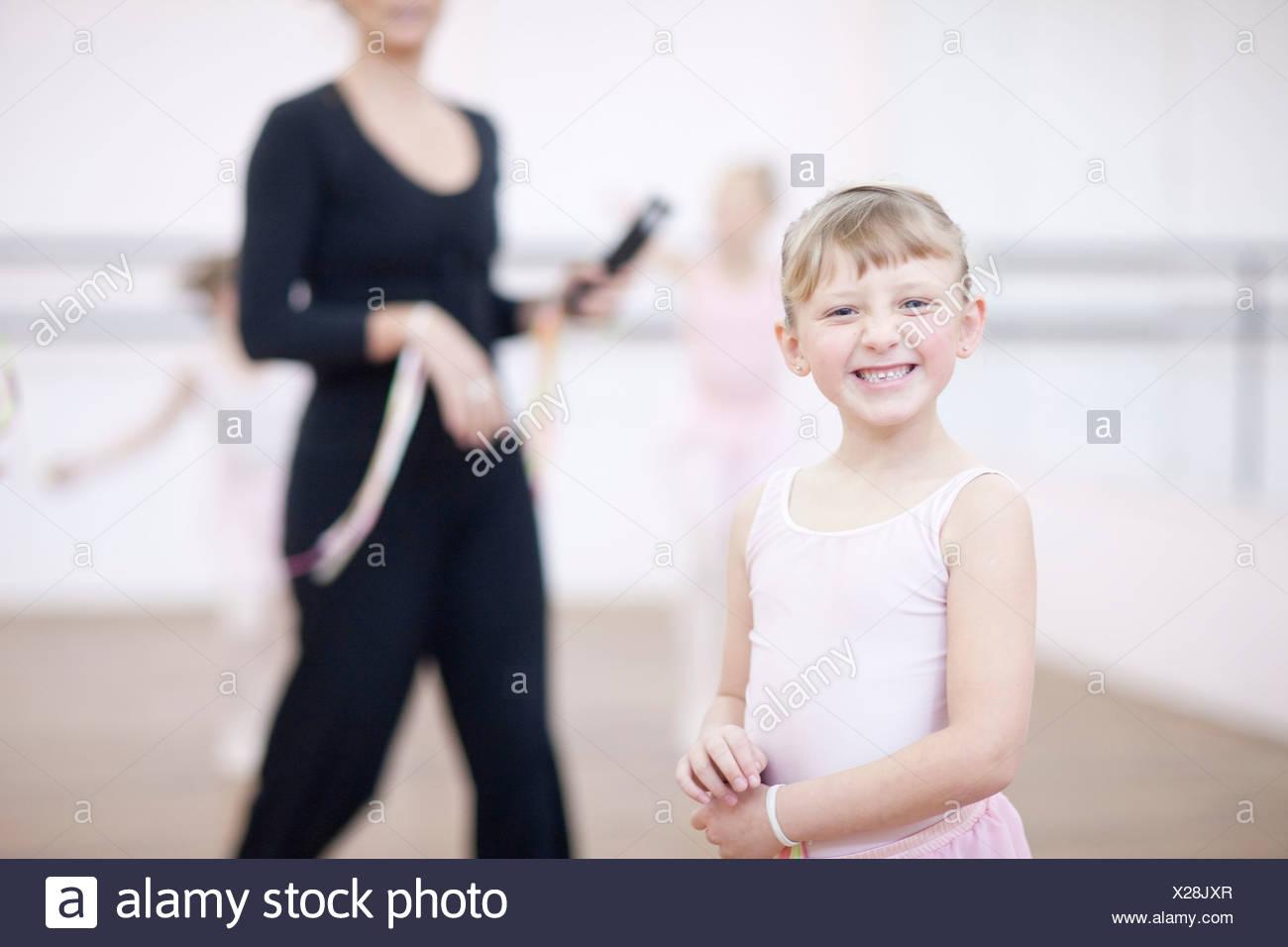 Portrait of mischievous young ballerina - Stock Image