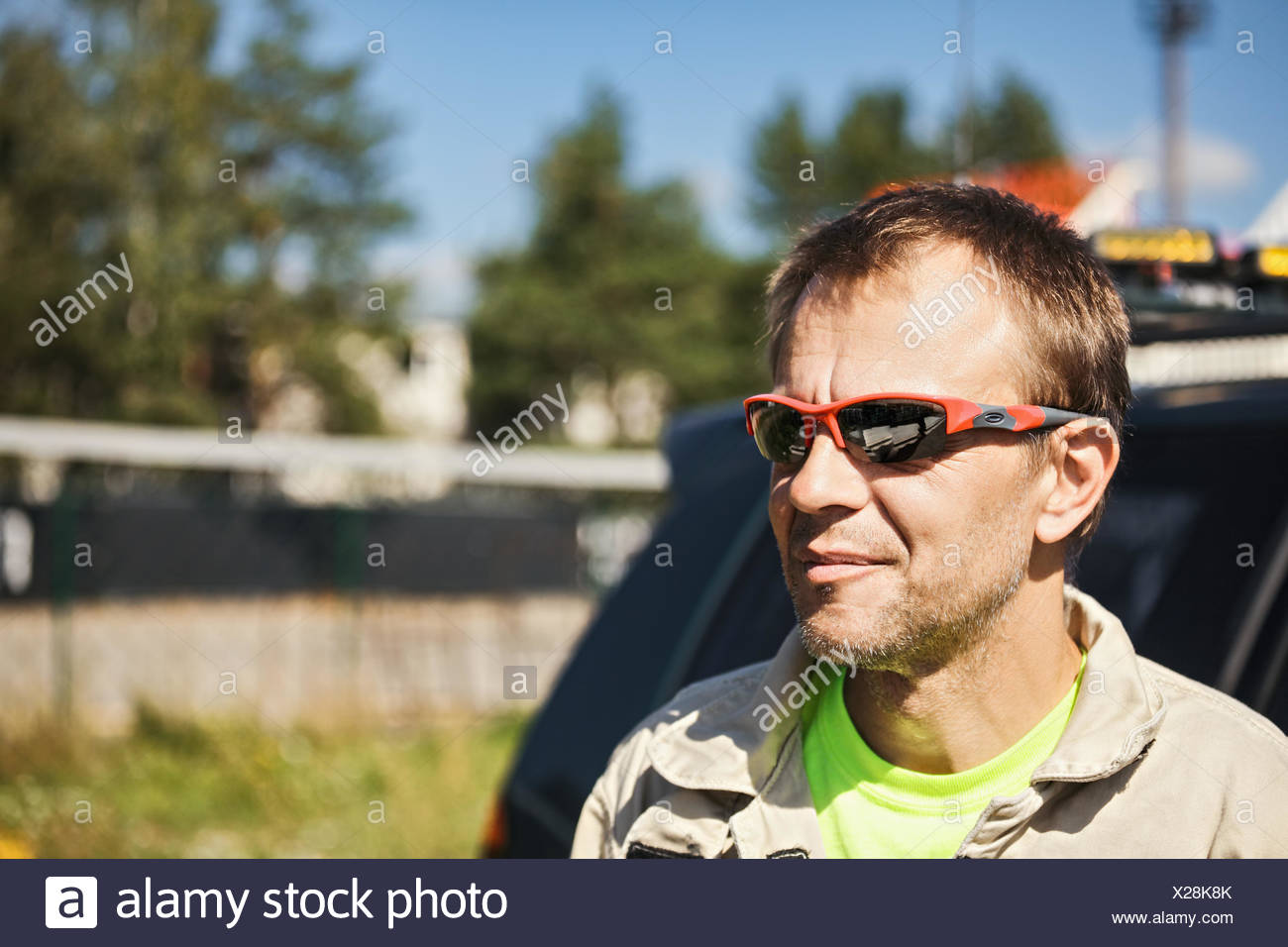 Contented rescuer at car - Stock Image