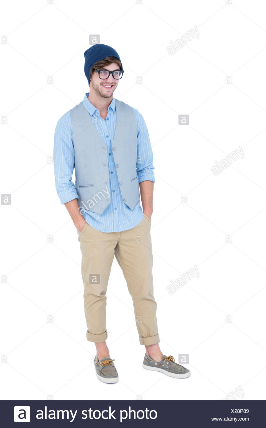 Geeky hipster with hands in pocket - Stock Image