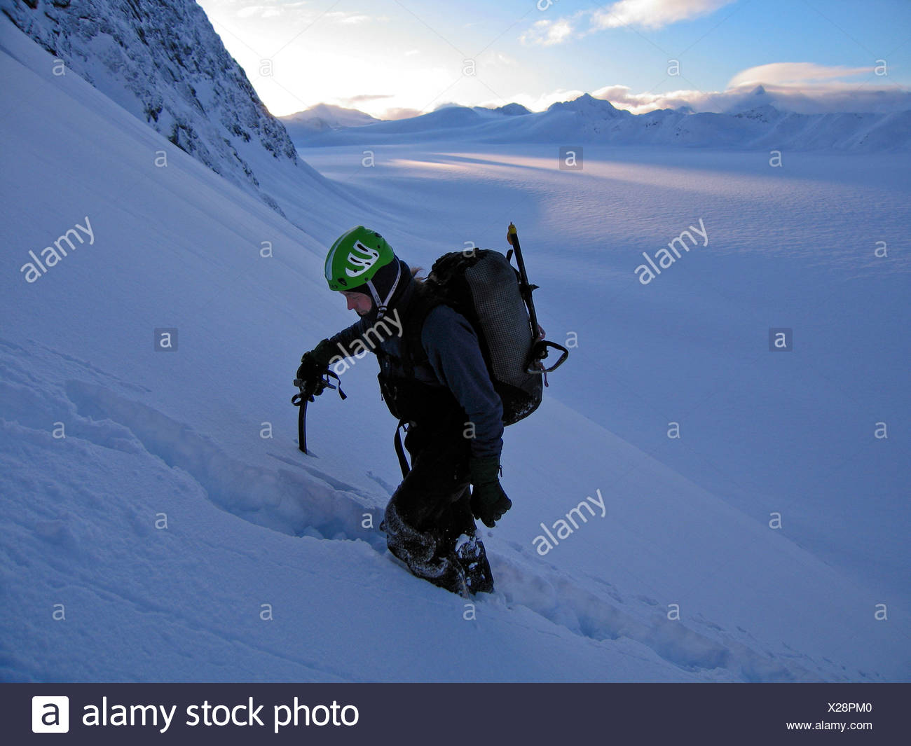 A climber ascends Peril Peak, in Chugach State Park, Alaska Stock Photo