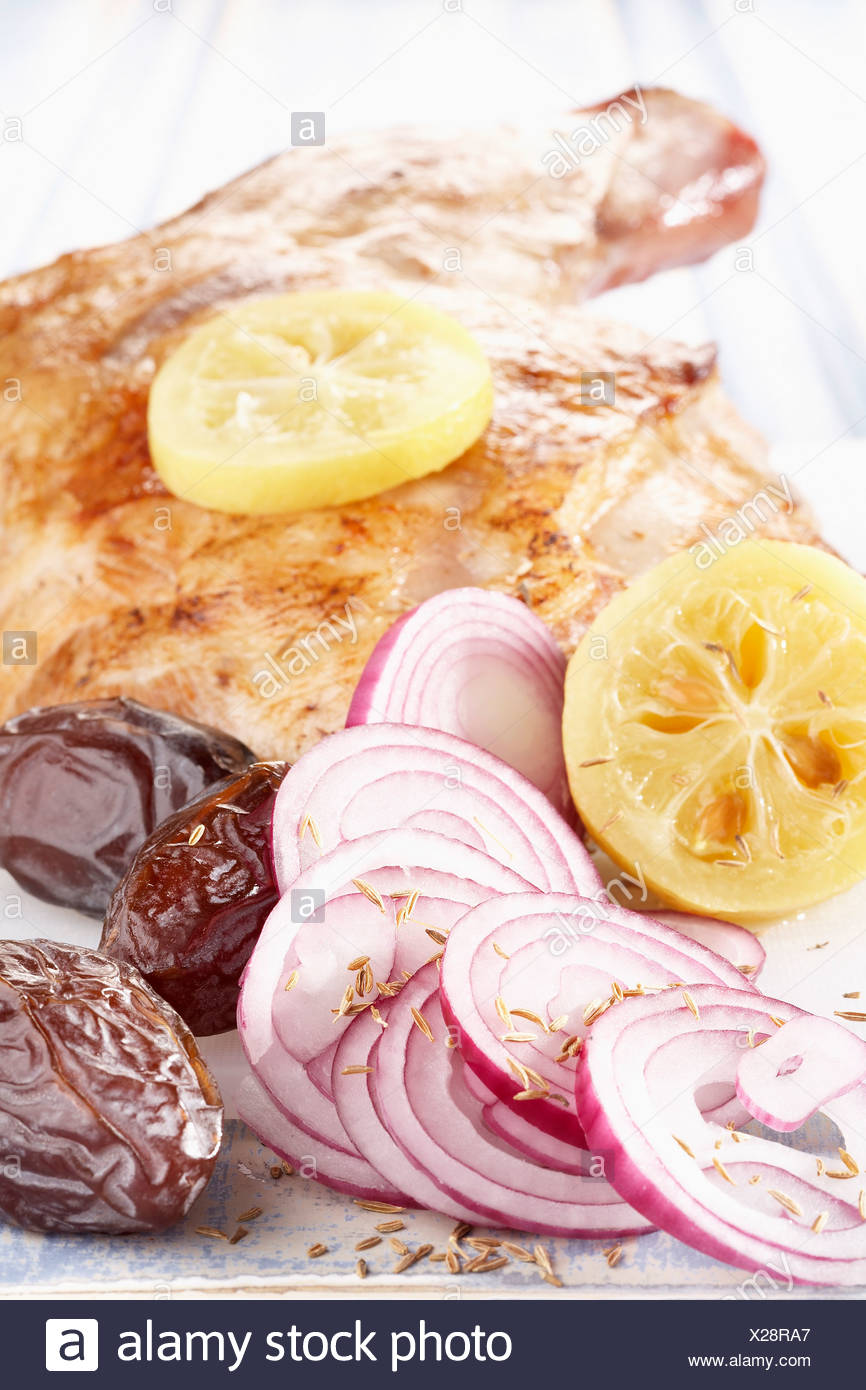 Leg of lamb with red onions,dates and confit lemons - Stock Image