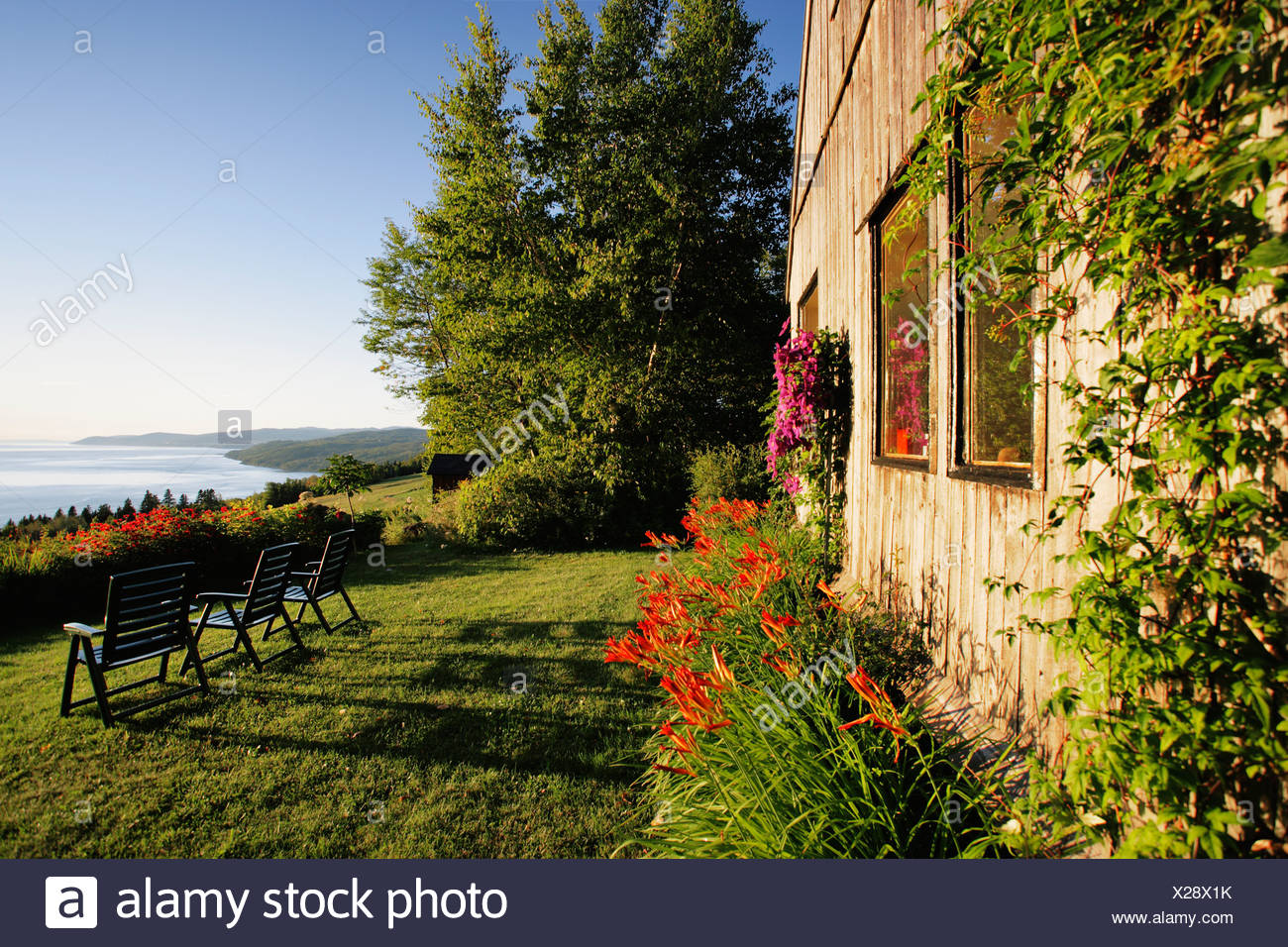 Cottage and St. Lawrence River, Charlevoix Region, Saint-Irenee, Quebec. - Stock Image