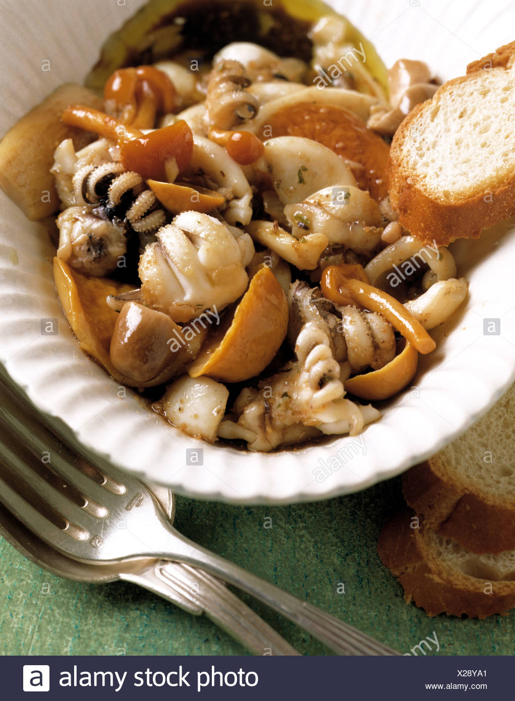Salad with squids and in oil soaked mushrooms - Stock Image