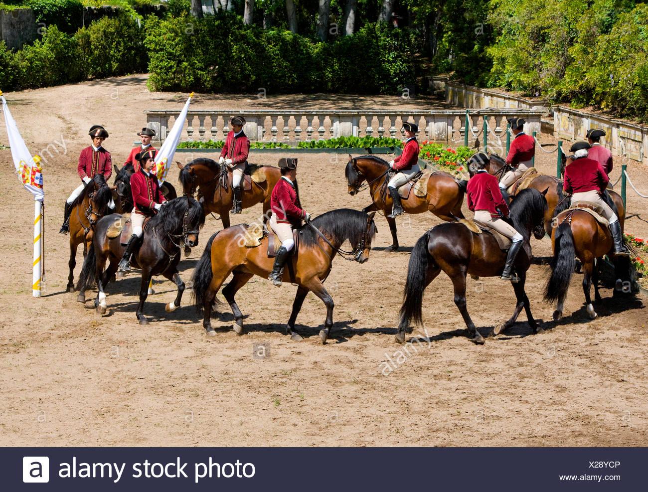 Riders of the Escola Portuguesa de Arte Equestre performing a quadrille. Queluz, Portugal. For editorial use only !. - Stock Image