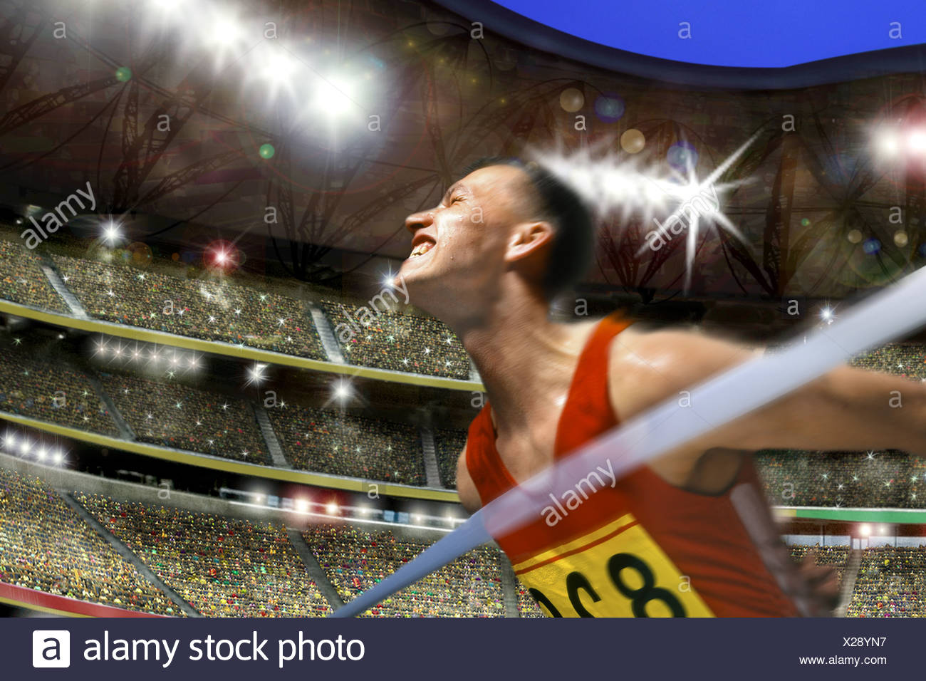 Runner, winner at the finish line just in front of the ribbon, stadium - Stock Image