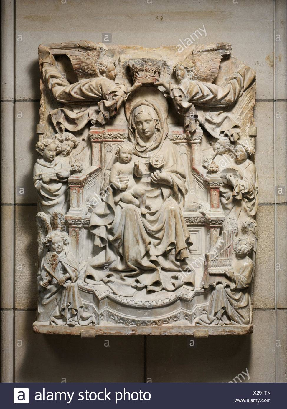 Relief with Enthroned Virgin and Child surrounded by Angels. Date: ca. 1425-40; Geography: Made in Veneto or Friuli, Italian; Culture: North Italian; - Stock Image