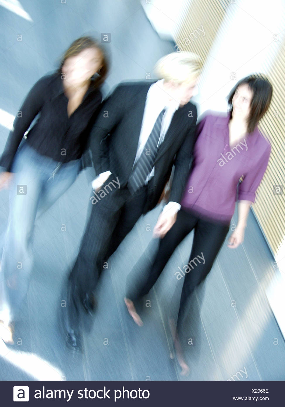 business,3 persons,dynamic Stock Photo