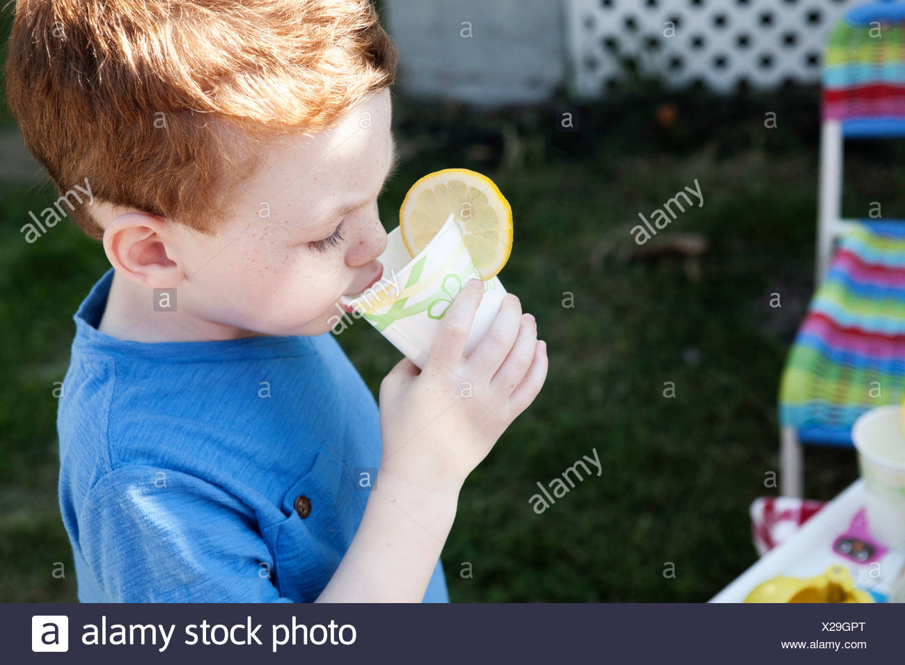 Boy drinking soft drink - Stock Image
