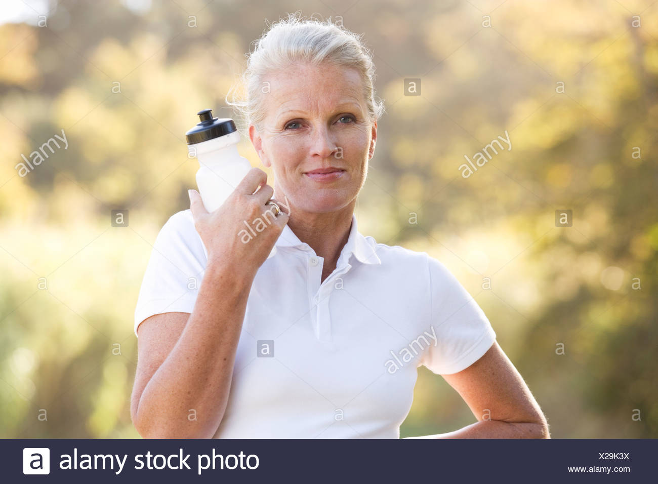 A senior woman keeping fit - Stock Image