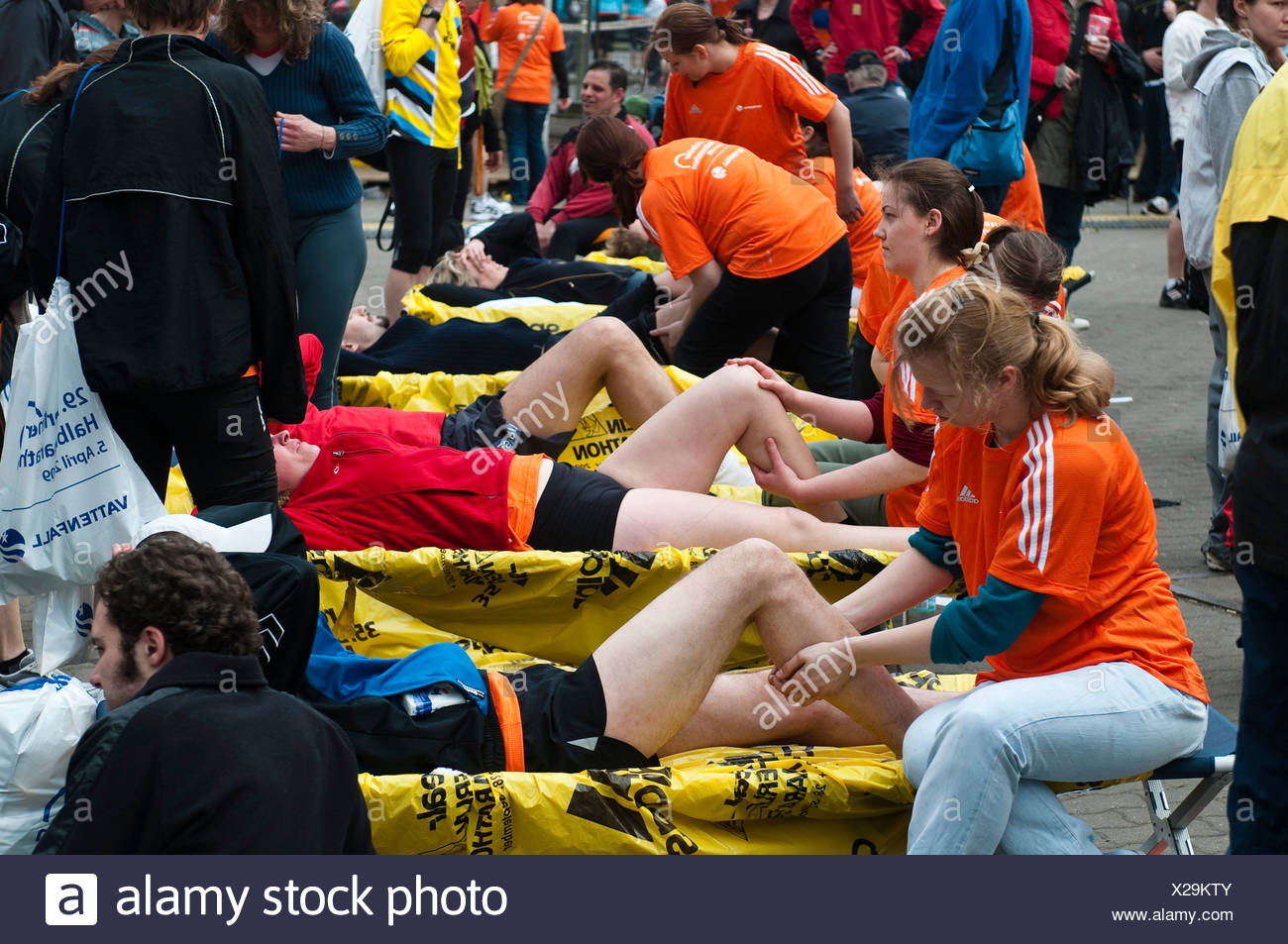 After the race runners can get massages, half marathon with over 25, 000 runners and wheelchair users, Berlin, Germany, Europe - Stock Image