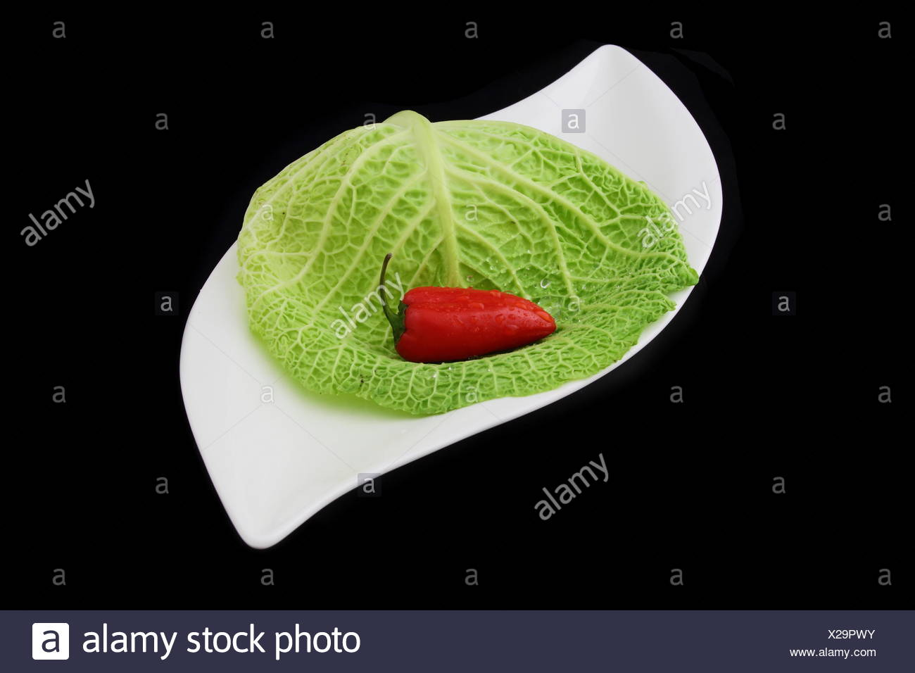 a red pepper on black Stock Photo