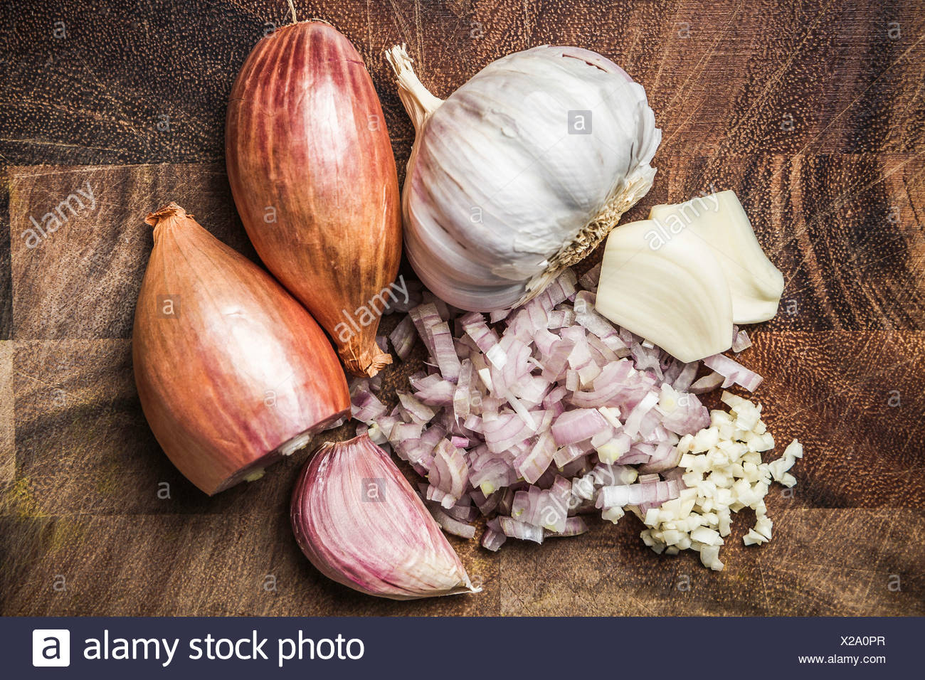 Ingredients for making green curry paste - onion, garlic - Stock Image