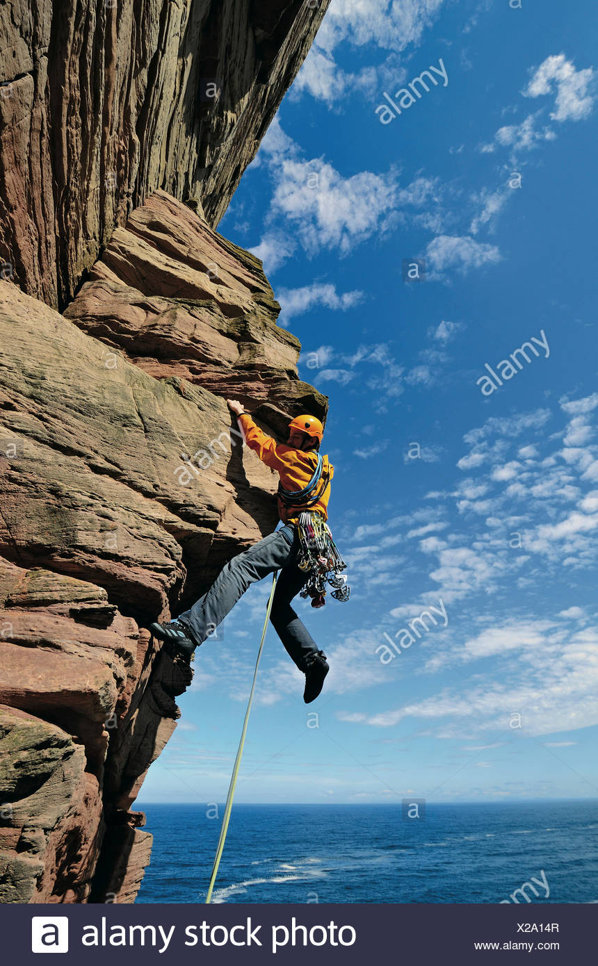 Climber ascending Old Man of Hoy, Hoy, Orkney Islands, Scotland, Great Britain - Stock Image
