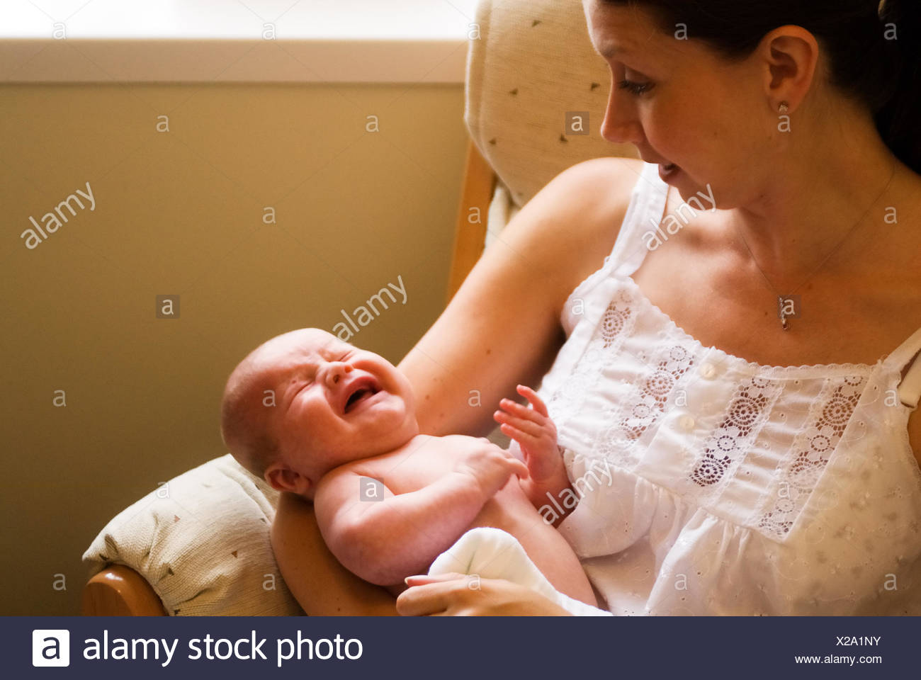 Crying in Mother's Arms - Stock Image