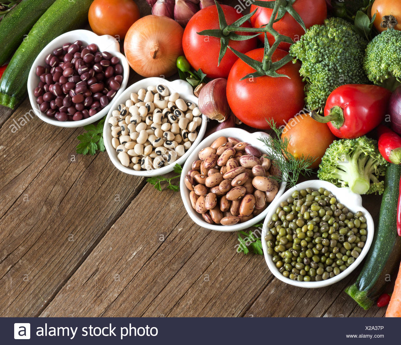 Legumes In Bowls And Vegetables Stock Photo Alamy