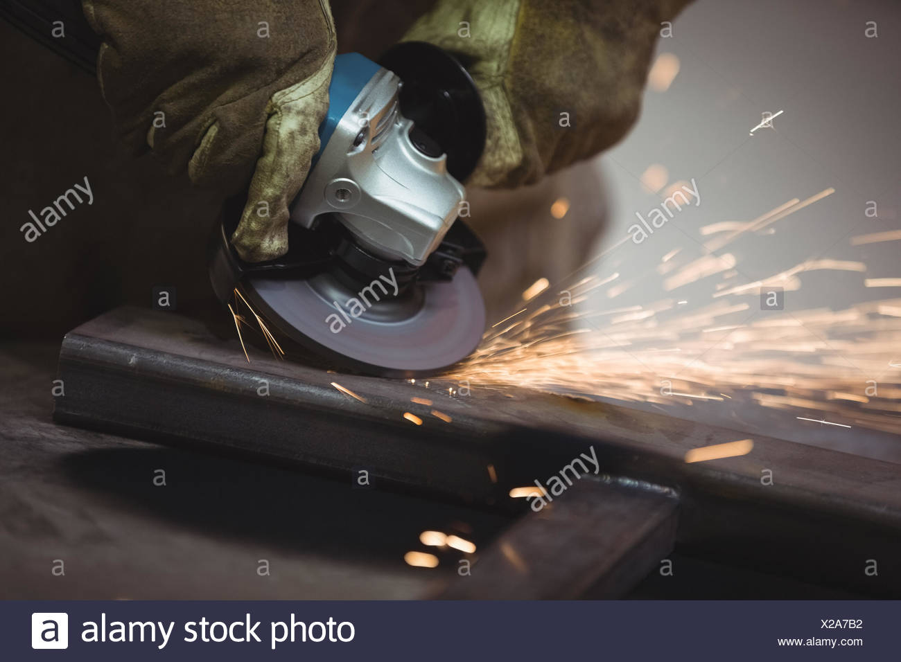 Worker using an angle grinder Stock Photo