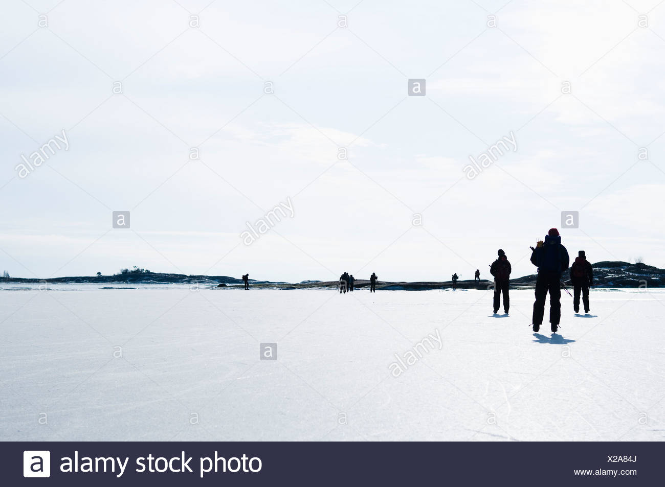 Ice skaters out on the ice - Stock Image