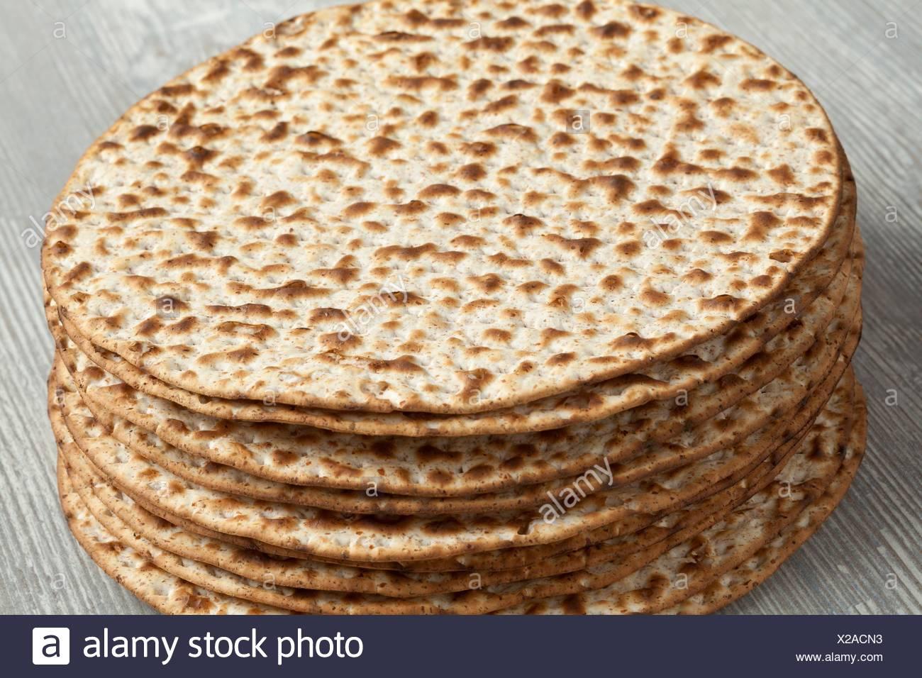 Pile of fresh wholewheat matzah. - Stock Image