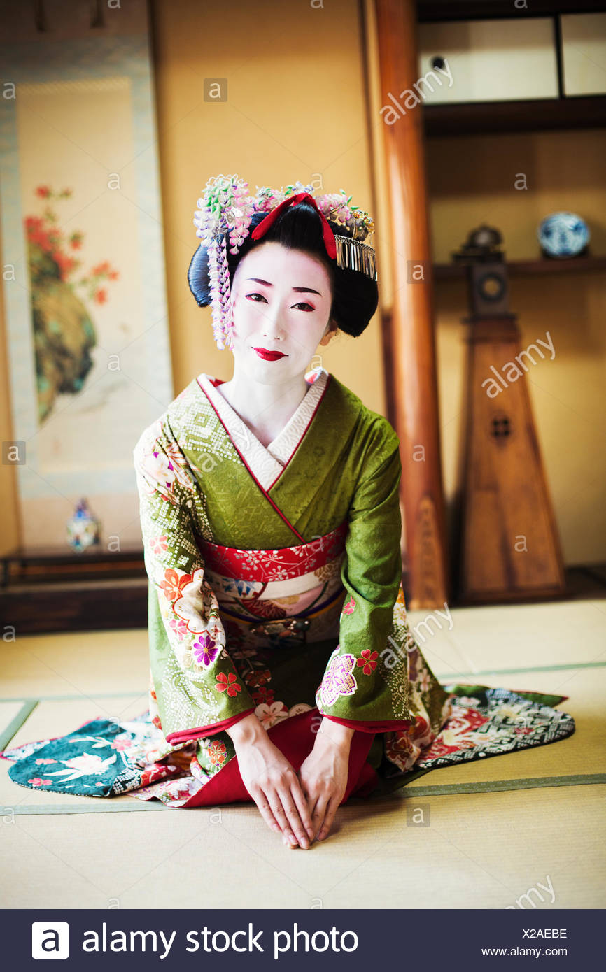 A woman dressed in the traditional geisha style, wearing a ...