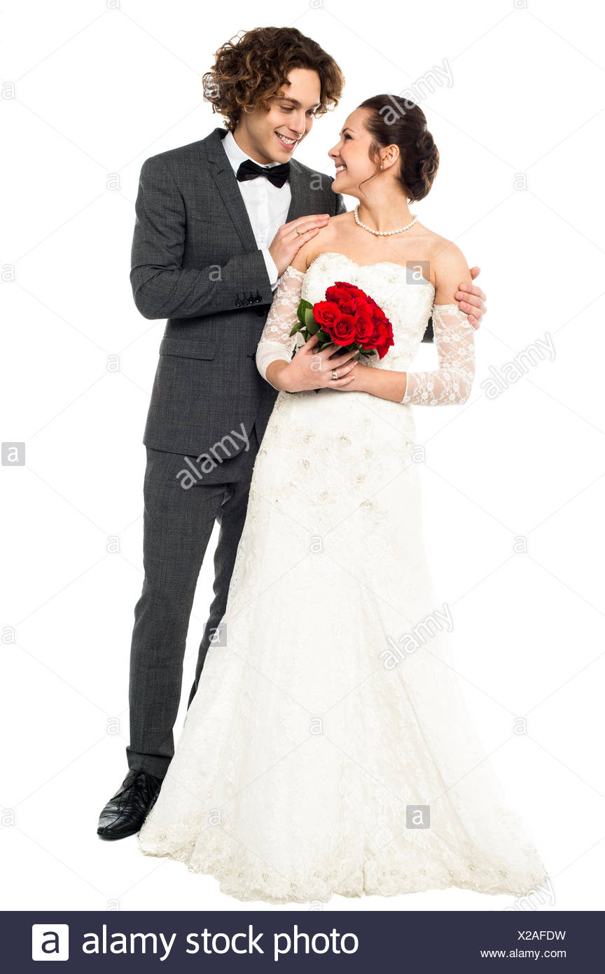 67157b6307a Romantic couple in bridal attire lost in each other Stock Photo ...