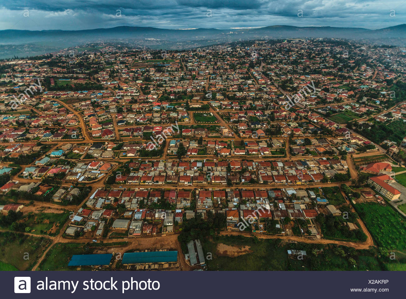 Aerial view of houses on the extreme edge between Volcanoes National Park and the farmlands in northern Rwanda. - Stock Image