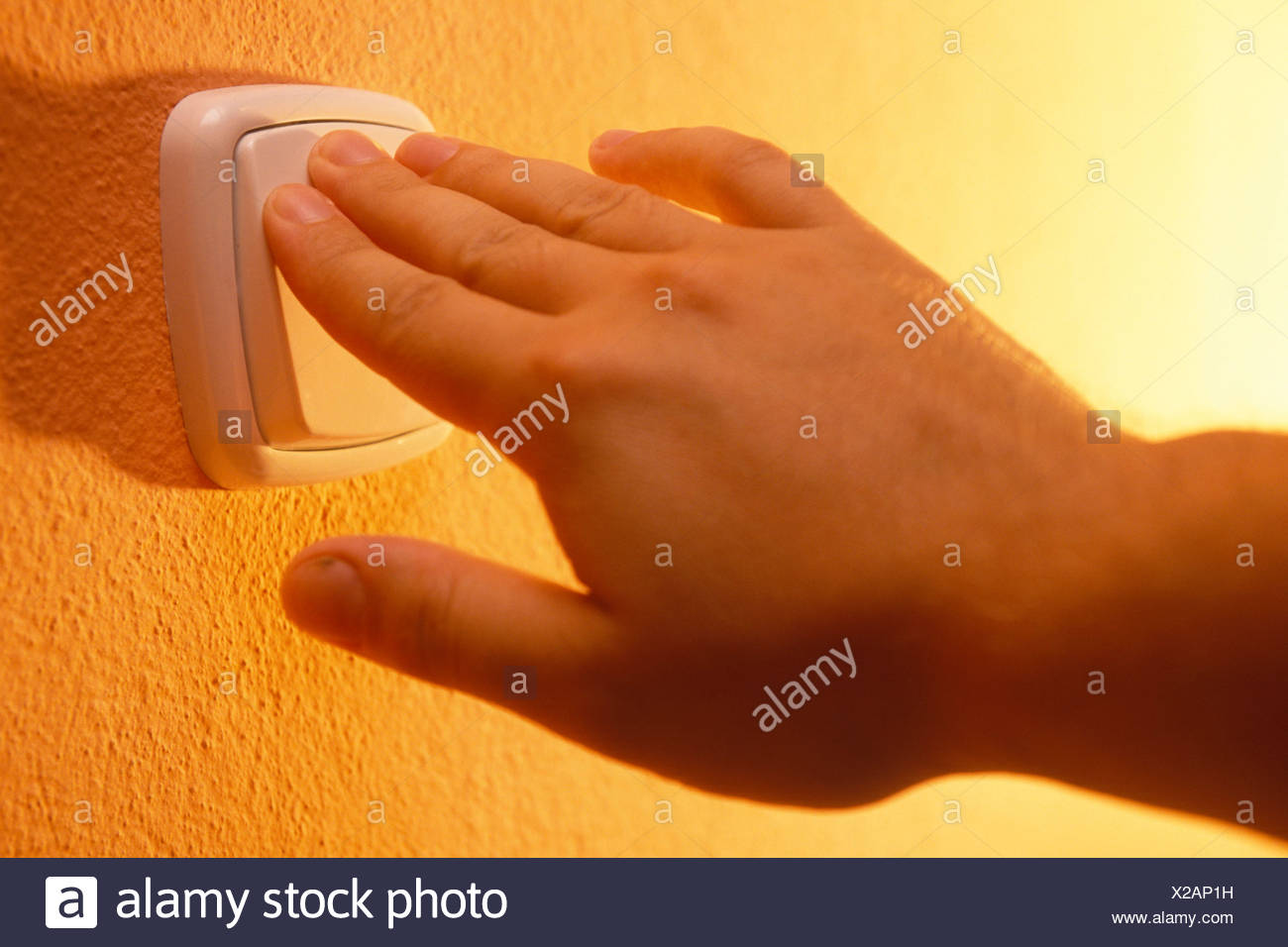 hands on light switch - Stock Image
