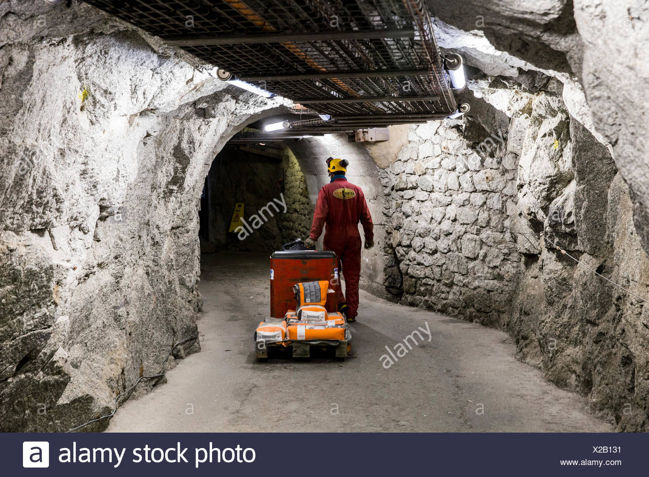 Worker carrying cement on electric pallet truck in of tunnels of Aiguille du Midi, Chamonix Mont-Blanc, Haute Savoie, France - Stock Image