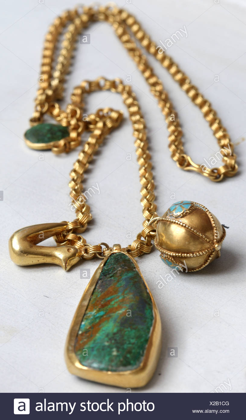 Detail image of long gold chain turquoise pendant and bird (£) from the Afghan Collection by jewellery designer Pippa Small at Stock Photo