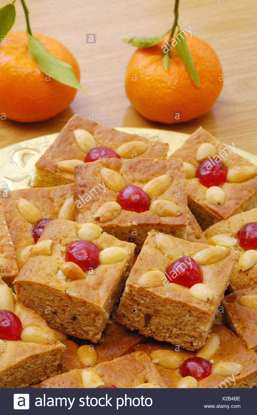 Plate, honey cakes, tangerines, medium close-ups, - Stock Image