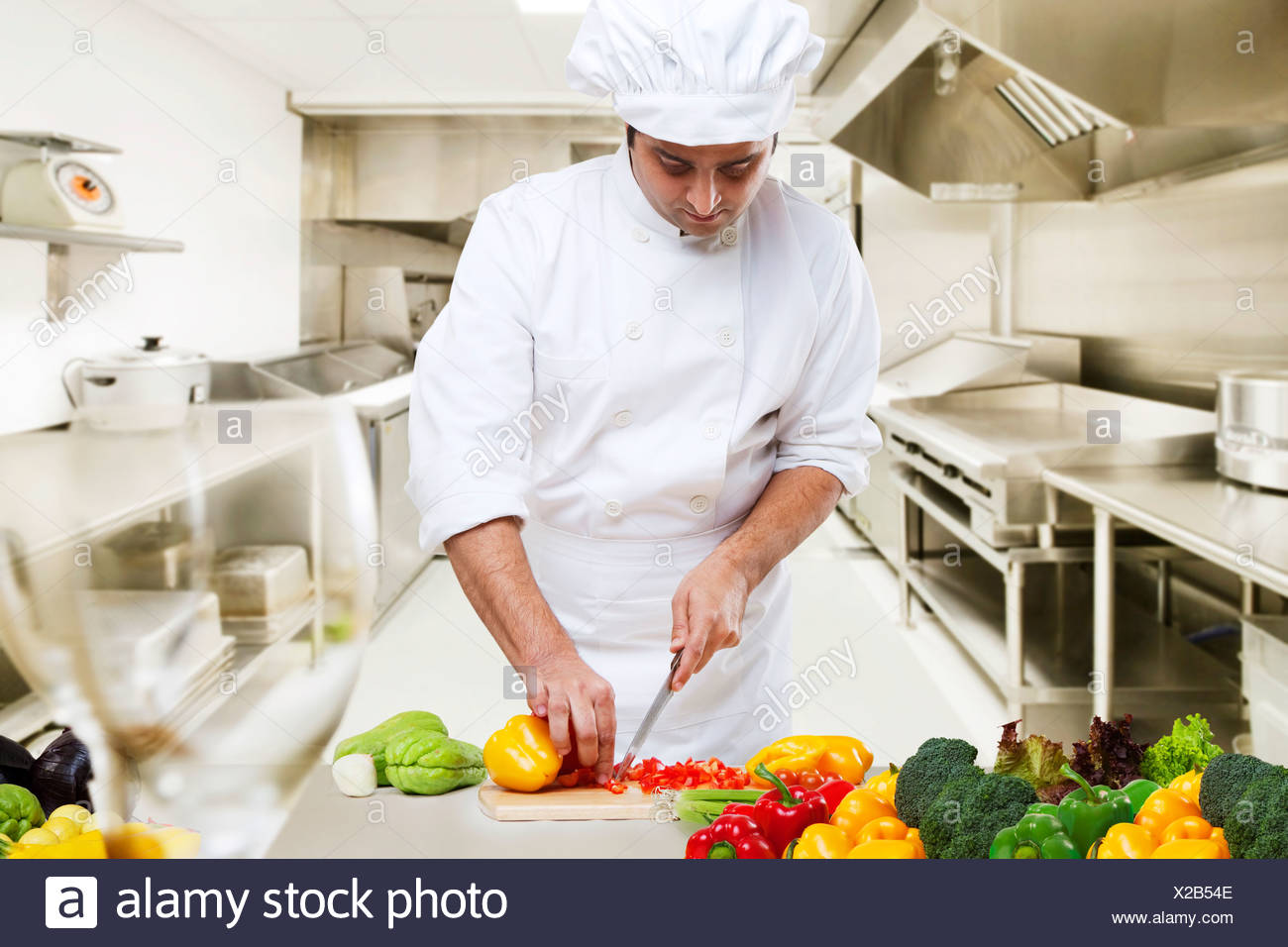 Chef cutting vegetables in the kitchen Stock Photo: 276840718 - Alamy