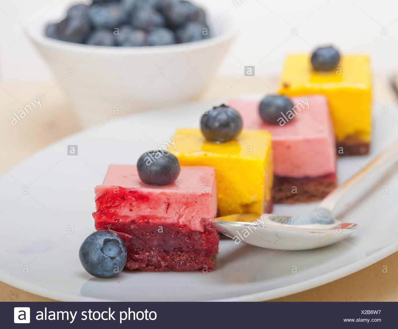fresh strawberry and mango mousse dessert cake with blueberry. - Stock Image