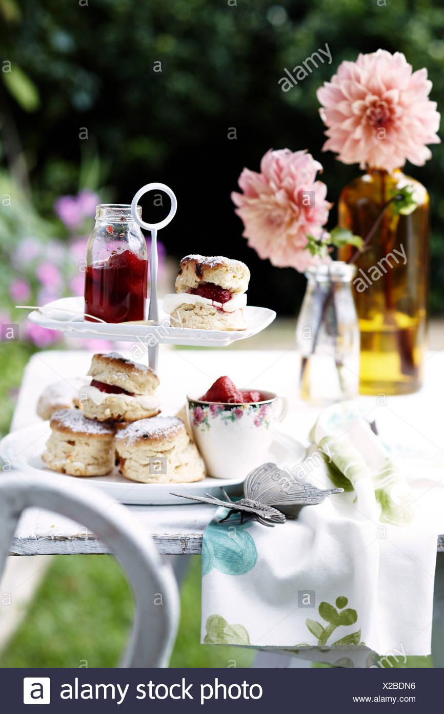 Scones with homemade strawberry jam and cream - Stock Image