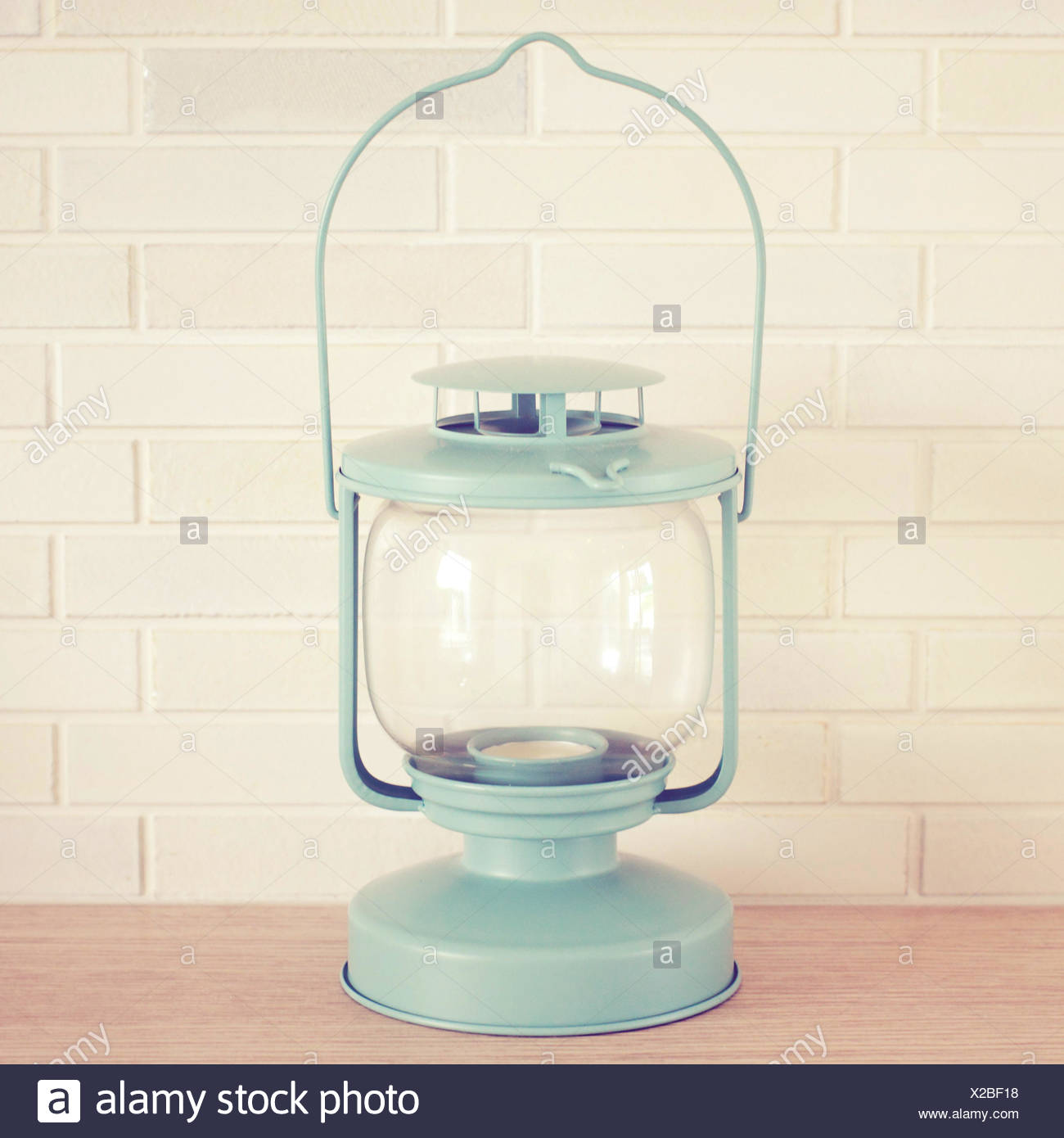 Vintage lamp on brick wall with retro filter effect - Stock Image