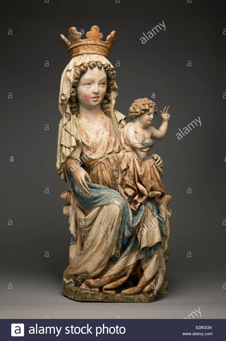 Enthroned Virgin and Child. Date: ca. 1350; Geography: Made in Brno?, Czech Republic; Culture: Bohemian or Moravian; Medium: Limewood with paint; - Stock Image