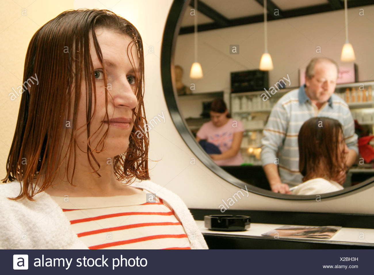 woman with wet hairs at the hairdresser - Stock Image