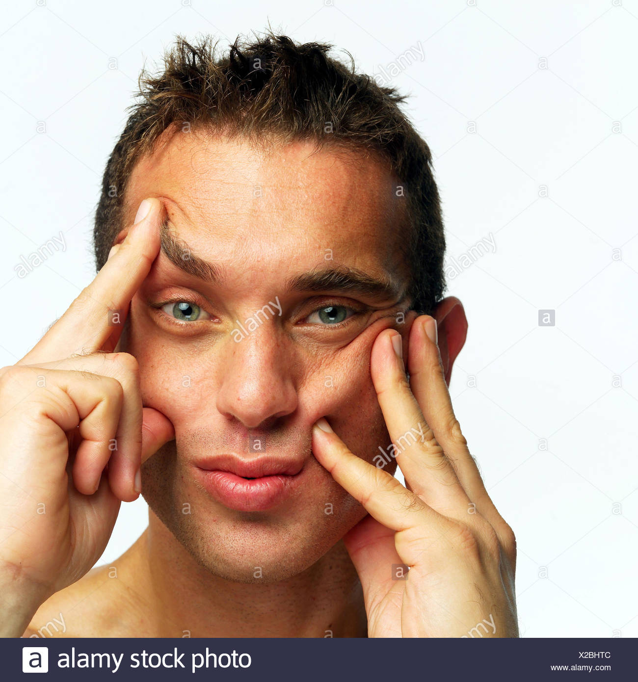 Man, young, gesture, portrait, very close, view camera, dark-haired, short hair hairstyle, hands, look, confuses, confusion, disorientated, disorientation, expression, facial play - Stock Image